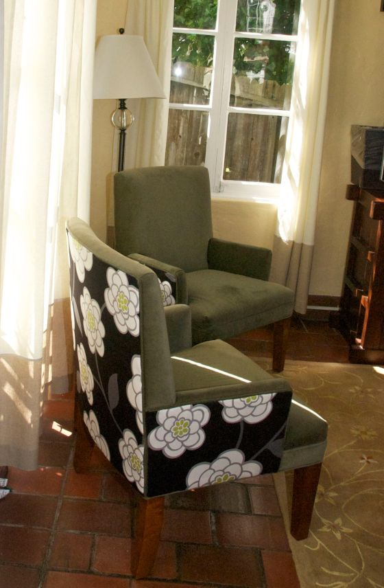 floral fabric on green chairs