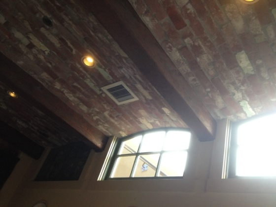 Brick-lined ceiling with exposed beams