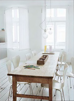 rustic table with modern chairs