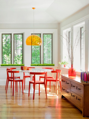 tulip table with red chairs