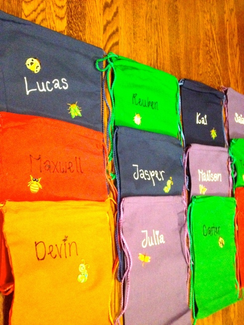 Drawstring backpacks decorated as treat bags by Jewels at Home.