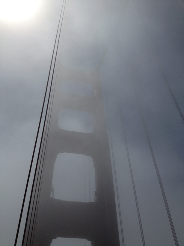 Sun shining through the fog on the Golden Gate Bridge