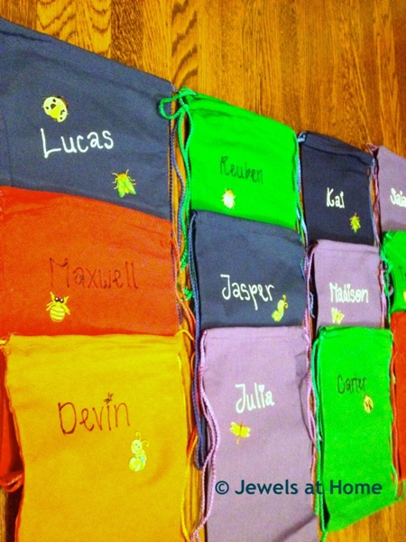 Decorate cloth bags for a birthday party favor that can be put to good use.  By Jewels at Home.