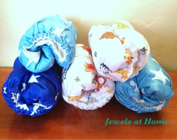 Making a diaper cake using cloth diapers by Jewels at Home