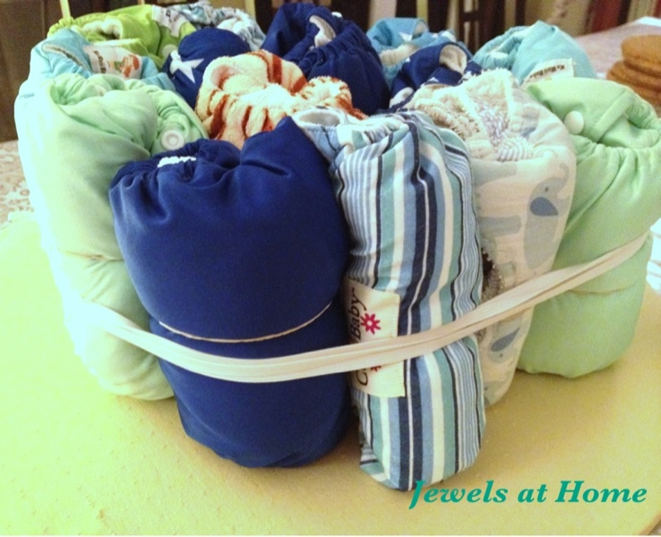 Make a diaper cake using cloth diapers by Jewels at Home
