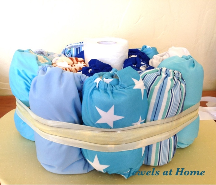 Making a diaper cake with cloth diapers by Jewels at Home.