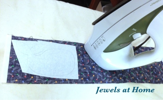 Cut out your design and iron it to the backside of the fabric.
