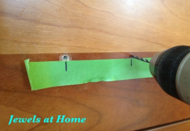 TIP: mark the distance between holes for cabinet hardware on a piece of painter's tape.  From Jewels at Home.