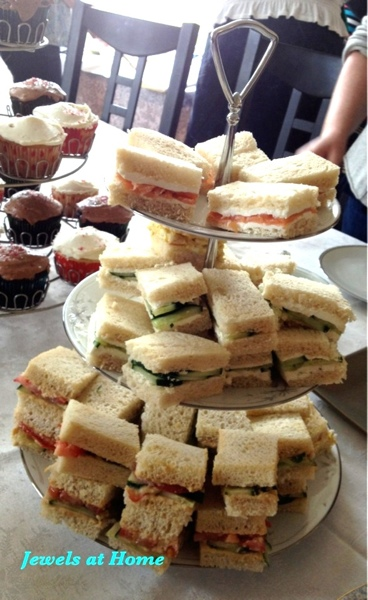 Sandwiches on a tiered serving tray are perfect for afternoon tea.