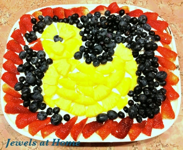 Ducky cake for baby shower.  Marble cake topped with whipped cream and fresh fruit.  Jewels at Home.