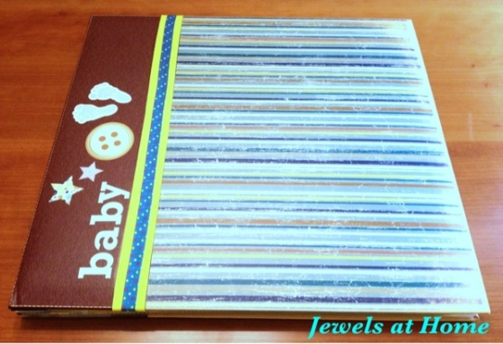 Decorate a scrapbook for a baby shower.  From Jewels at Home.