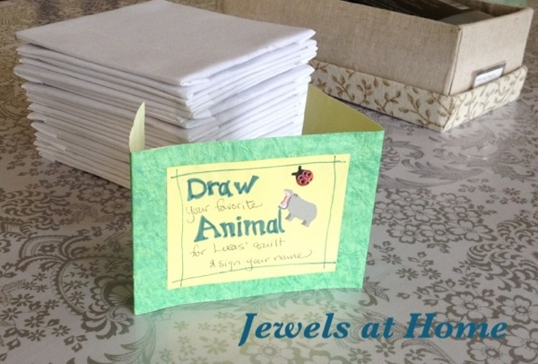 Decorate-a-quilt-block activity at a birthday or baby shower.  From Jewels at Home.