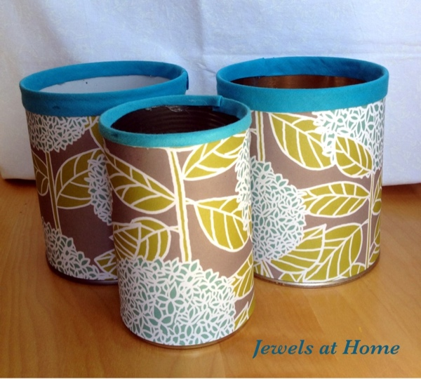 Beautiful pencil tins made from old cans, decorative paper, and bias tape. Tutorial from Jewels at Home.