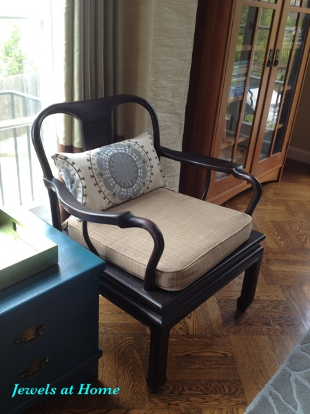 Living room vignette with vintage chair, painted chest, and new cushions.  From Jewels at Home.