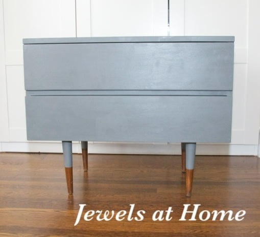 "Mid-Century dresser painted in Benjamin Moore Amherst Gray with reverse ""dipped"" legs. Get the same look with a Ikea Sveio hack.  From Jewels at Home."