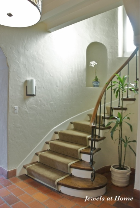 A classic stairway with a new look. Walls are Manchester Tan from Benjamin Moore. From Jewels at Home.