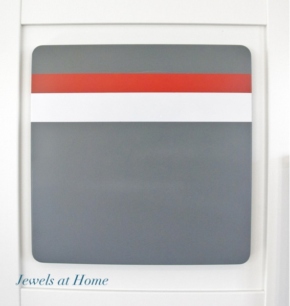 Magnet board with racing stripes.  Tutorial from Jewels at Home.