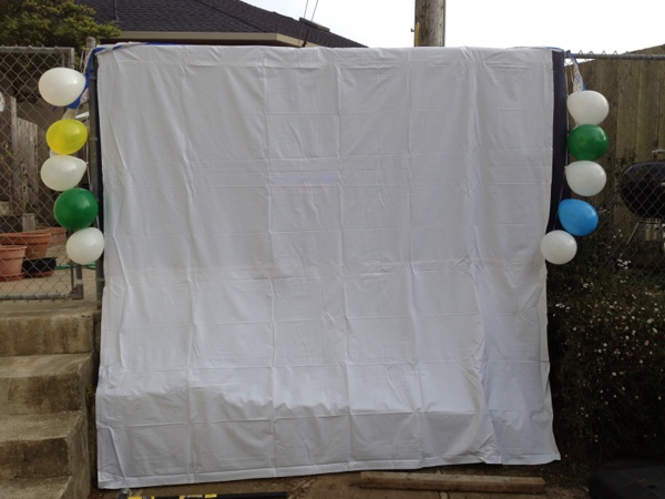 Canvas drop cloth used as a movie screen.  Via Jewels at Home.