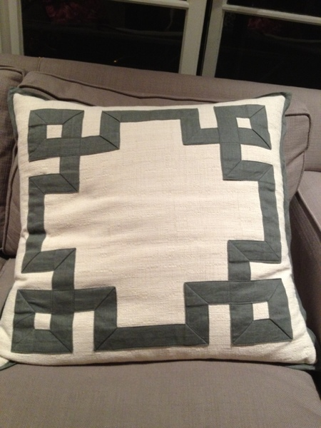 Ribbon-bordered throw pillow.  Spotted by Jewels at Home.