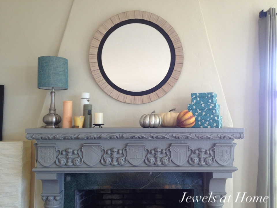 Warm fall mantel with metallic pumpkin!  Jewels at Home.