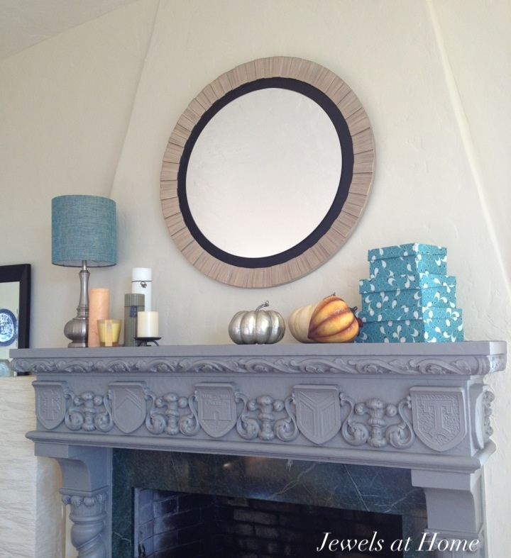 Warm fall mantel with metallic pumpkin!  Jewels at Home.