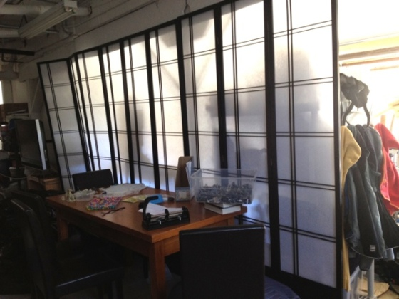 Shoji screens in extra-tall heights can be used to create a floor-to-ceiling room divider that lets light filter through.  Jewels at Home.