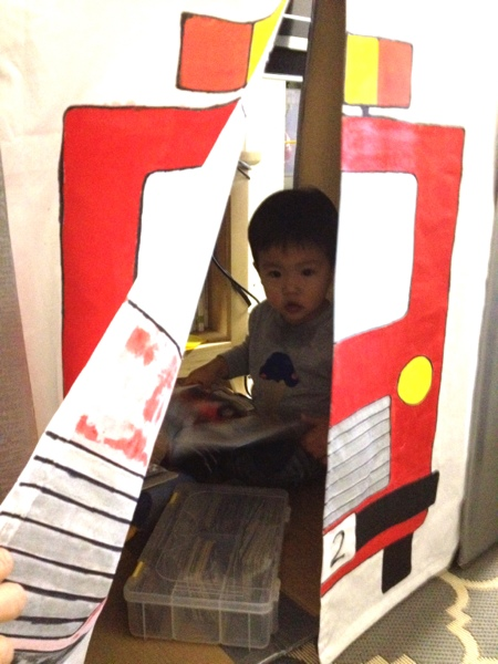 DIY cardboard fire station play house - it can be folded flat for storage.  Jewels at Home.