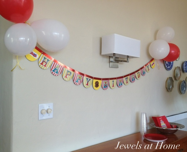 Firefighter birthday party decorations.  So easy to reuse this banner by changing from a circus theme to a firefighter theme.  Jewels at Home.