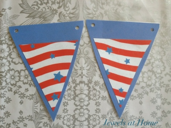 Making pennants for a birthday banner.  Cover the paper with clear contact paper, so decorations can be switched out according to the party's theme.  Jewels at Home.