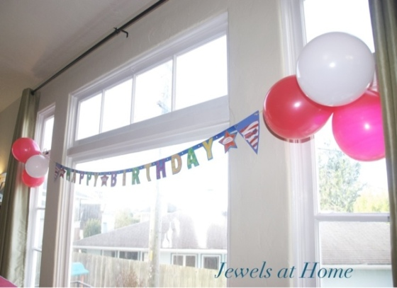 A plain banner customized for a firefighter birthday using removable decorations.  This banner can be used over and over again for different parties!  Jewels at Home.