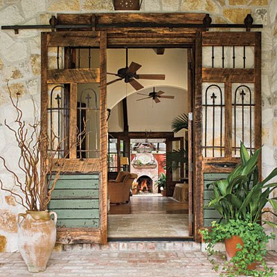 Salvaged doors installed to slide on a rail. Shown at Lavender and Lilies. & Renteru0027s Dilemma: Covering a Large Doorway   Jewels at Home