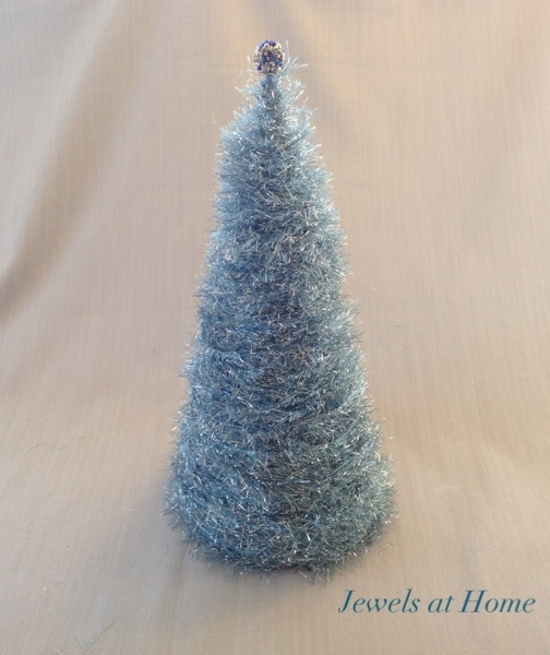 Use glitter eyelash yarn to make your own decorative Christmas tree.  Easy, inexpensive, and unique holiday decor!  From Jewels at Home.