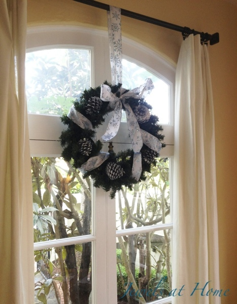 This wreath over a big french door can be enjoyed from the inside and out.  Christmas house tour from Jewels at Home.