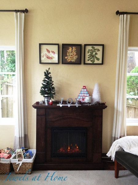 SImple Christmas mantel in silver, turquoise, and red.  Christmas house tour from Jewels at Home.