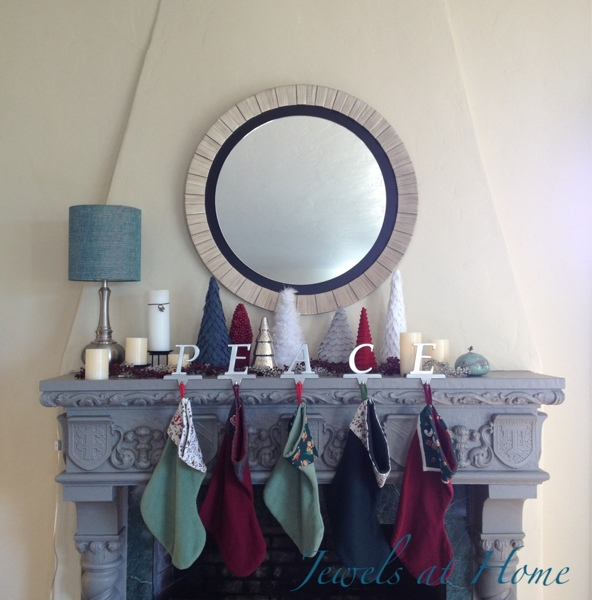 Christmas mantel filled with homemade trees.  Christmas house tour from Jewels at Home.