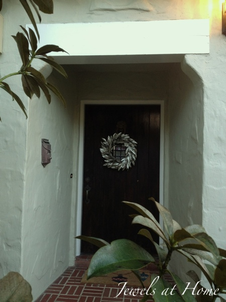 Silver wreath welcomes you home.  Christmas house tour from Jewels at Home.