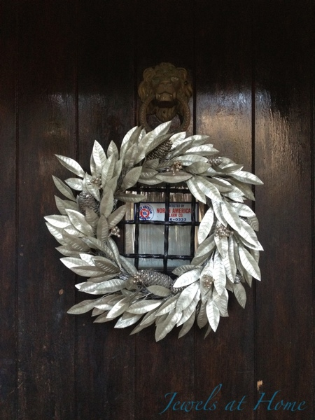 Silve wreath gives an elegant look to the front door.  Christmas house tour from Jewels at Home.