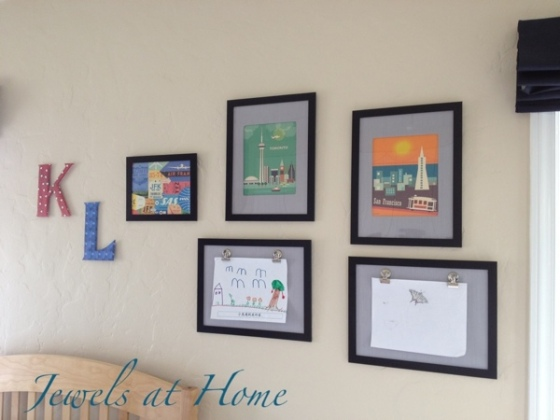 Kids' gallery wall with retro travel art, DIY wall initials and DIY frames with clips to change art.  Click for details and tutorials.  {Jewels at Home}