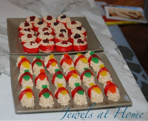 Rice Krispy Treat sushi made from Rice Krispies cereal and candy.  More ideas for a Ninjago birthday party at Jewels at Home.