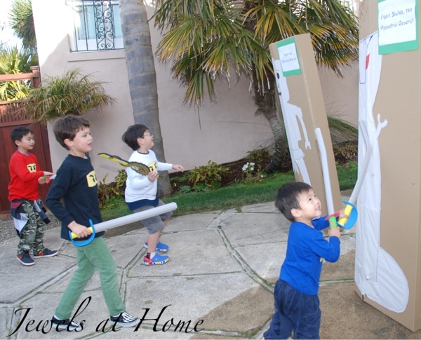 Sword fighting targets for a Ninjago birthday party activity.  Many more ideas from Jewels at Home.