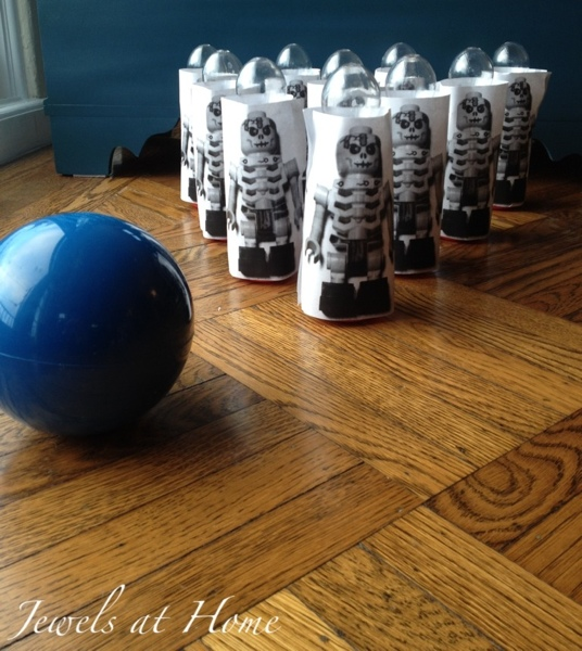DIY life-sized Ninjago skeleton bowling game.  Many more ideas for a Ninjago birthday party from Jewels at Home.