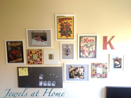 Vintage comic-themed gallery wall with DIY mirror frame, wall initials, and gallery clip frames.  Includes link to a source for these beautiful vintage comic covers.  {Jewels at Home}