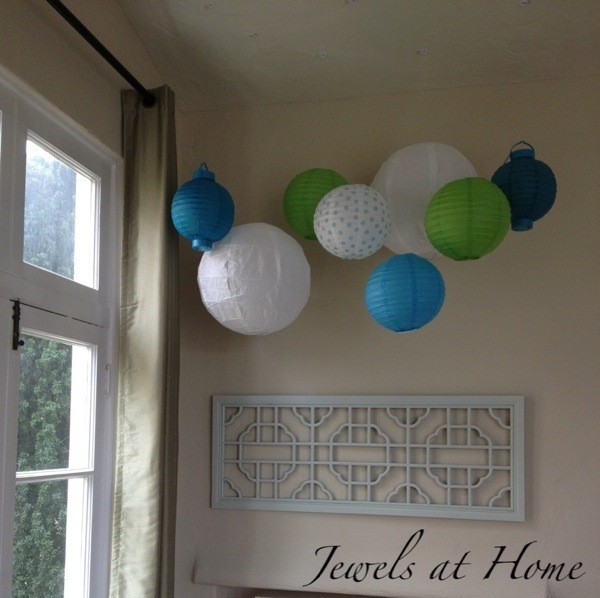 A collection of colorful paper lanterns brings the garden party inside.  {Jewels at Home}