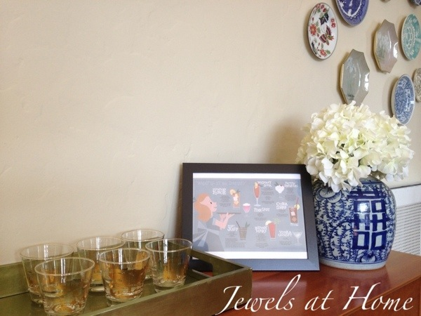 Mad Men Party dry bar set-up with vintage glasses and Mad Men-inspired art  | Jewels at Home