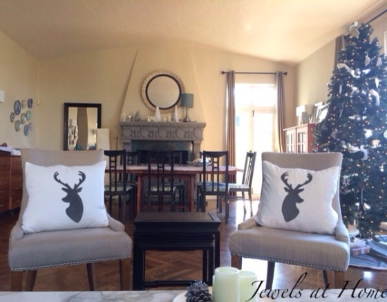 Holiday decorating.  Living room with new polar bear, snowy forest, and reindeer pillows for Christmas and the whole winter | Jewels at Home