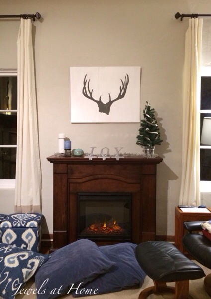 DIY reindeer antler silhouette painting.  In simple white and gray, this creates a cozy lodge feeling with a whimsical and modern twist | Jewels at Home