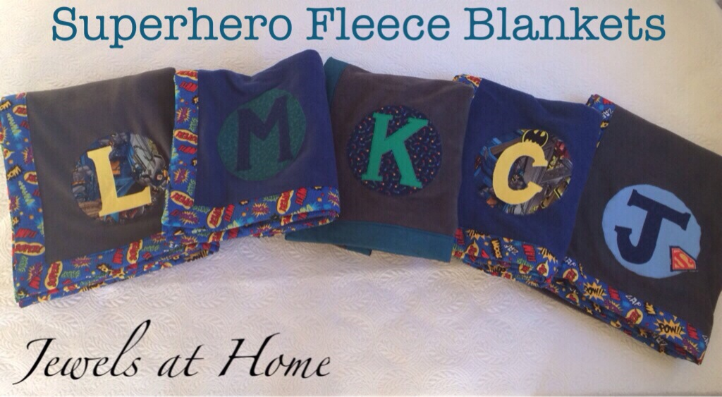 Superhero-themed monogrammed fleece blankets for a boys' sleepover party | Jewels at Home