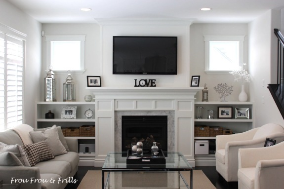 Frou Frou & Frills: http://www.froufrouandfrills.com/fireplace-built-ins/